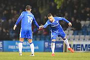 Gillingham defender Max Ehmer (5) shared hands in celebration with Gillingham's Baily Cargill during the EFL Sky Bet League 1 match between Gillingham and Northampton Town at the MEMS Priestfield Stadium, Gillingham, England on 12 November 2016. Photo by Martin Cole.