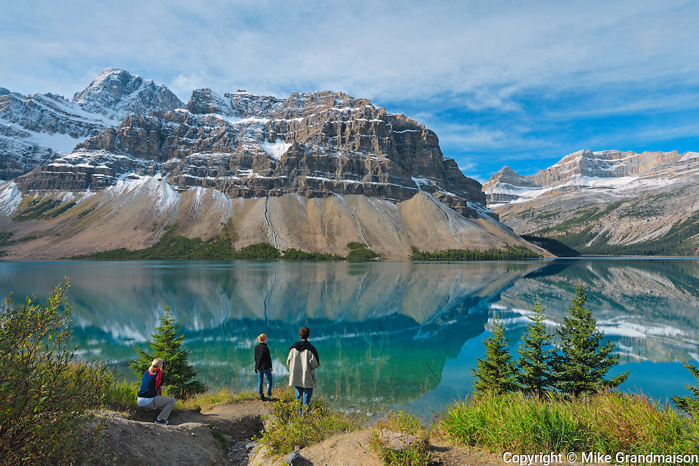 Tourists enjoying the view of the Canadian Rocky Mountains at Bow Lake on the Icefields Parkway<br /> Banff National Park<br /> Alberta<br /> Canada