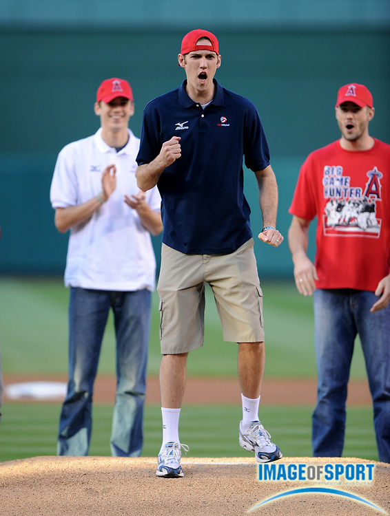 May 28, 2008; Anaheim, CA, USA; USA volleyball outside hitter Scott Touzinsky throws out the first pitch before game between the Detroit Tigers and Los Angeles Angels at Angel Stadium. Mandatory Credit: Kirby Lee/Image of Sport-US PRESSWIRE