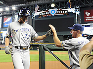 Jul 14, 2013; Phoenix, AZ, USA;  Milwaukee Brewers outfielder Logan Schafer (22) is congratulated by manager Ron Roenicke (10) after hitting a solo home run against the Arizona Diamondbacks in the fifth inning at Chase Field.  The Brewers defeated the Diamondbacks 5-1.  Mandatory Credit: Jennifer Stewart-USA TODAY Sports