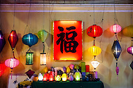 Lanterns displayed along a wall in Hoi An, Vietnam, Southeast Asia