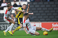 Rhys Healey of Colchester United looks to get a shot at goal while under pressure from Tom Flanagan of MK Dons during the Sky Bet League 1 match between Milton Keynes Dons and Colchester United at stadium:mk, Milton Keynes<br /> Picture by Richard Blaxall/Focus Images Ltd +44 7853 364624<br /> 29/11/2014