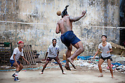 Some players of chinlone practicing this sport in a landfill. Yangon, Myanmar.