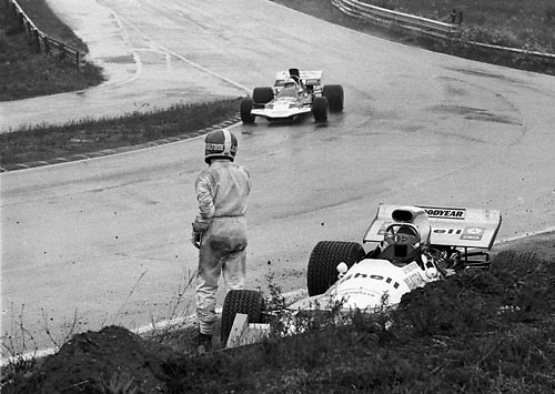 John Surteees in Surtees TS9 passes the crashed Jean-Pierre Beltoise during the wet 1971 Canadian Grand Prix at Mosport Park; Photo by Pete Lyons 1971/ © 2014 Pete Lyons / petelyons.com