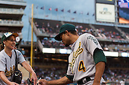 Oakland Athletics Coco Crisp signs an autograph for a fan before a game against the Minnesota Twins on July 13, 2012 at Target Field in Minneapolis, Minnesota.  The Athletics defeated the Twins 6 to 3.  © 2012 Ben Krause