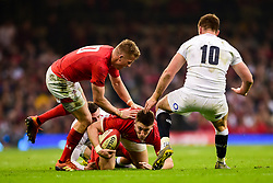 Josh Adams of Wales is tackled - Mandatory by-line: Ryan Hiscott/JMP - 23/02/2019 - RUGBY - Principality Stadium - Cardiff, Wales - Wales v England - Guinness Six Nations