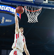 Watertown High School senior John Korte dunks the ball during the MIAA Division 3 North sectional final against St. Mary's at the Tsongas Center in Lowell, March 10, 2018. Watertown won the game, 44-36.   [Wicked Local Photo/James Jesson]