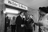 Democratic candidate for the U.S. Senate Barack Obama campaigns at West Point Missionary Baptist Church on the south side of Chicago Sunday March 14, 2004. Obama shakes the hands of Cynthia Geralds on his way out.  At right is Kathryn Newcomb.