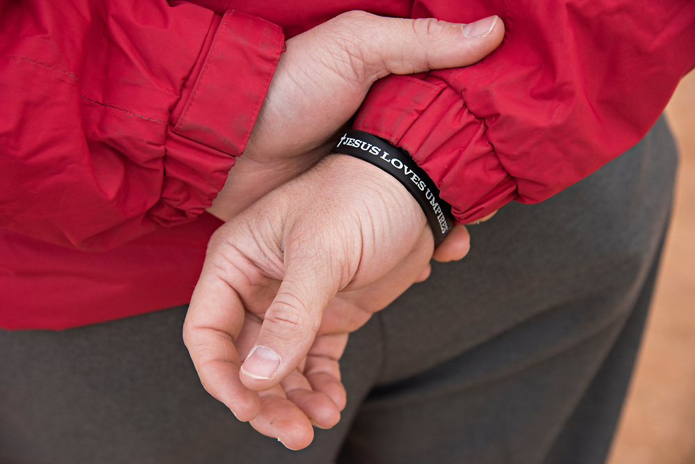 "A bracelet on an instructor at the Wendelstedt Umpire School declares ""Jesus Loves Umpires."""