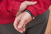 """A bracelet on an instructor at the Wendelstedt Umpire School declares """"Jesus Loves Umpires."""""""