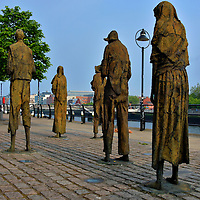 Famine Sculptures in Dublin, Ireland <br /> In the mid-19th century, a large percent of the Irish population were impoverished and over 60% were reliant on agriculture for their merger incomes. The primary crop was potatoes.  So when late or potato blight occurred in 1845, the disease had devastating effects. Over one million people died through 1845 during the Great Famine.  Another million emigrated.  Many stumbled towards ships docked along Custom House Quay. These bronze sculptures, created by Rowan Gillespie in 1997, memorializes this horrendous period.