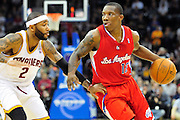 Feb. 11, 2011; Cleveland, OH, USA; Los Angeles Clippers point guard Eric Bledsoe (12) drives past Cleveland Cavaliers point guard Mo Williams (2) during overtime at Quicken Loans Arena. The Cavaliers broke their loosing streak beating the Clipper 126-119 in overtime. Mandatory Credit: Jason Miller-US PRESSWIRE