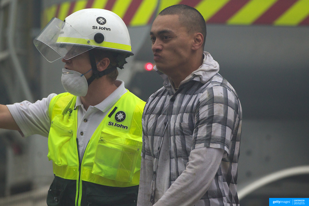 Topi Mery  as he emerges from the wreckage of the CTV building in Christchurch City Centre after five hours trapped in the rubble after a Powerful earth quake ripped through Christchurch, New Zealand on Tuesday lunch time killing at least 65 people as it brought down buildings, buckled roads and damaged churches and the Cities Cathedral. Photo Tim Clayton