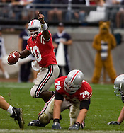MORNING JOURNAL/DAVID RICHARD.Quarterback Troy Smith signals for a receiver to go long before completing a first down pass to split end Anthony Gonzalez.