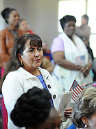 DUBLIN, PA - OCTOBER 24: Raquel Puente (L), of Equador and fellow applicants wait to take the Oath of Citizenship during a Naturalization ceremony October 24, 2014 at the Pearl S. Bucks House in Dublin, Pennsylvania. 48 applicants from 28 countries were naturalized during the ceremony, and became U.S. citizens. (Photo by William Thomas Cain/Cain Images)