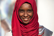 A Sudanese girl takes part in the International Migrants Day celebration organized by UNHCR partner agency IOM December 16 2017 in the Maadi district of Cairo, Egypt. The International Migrants Day celebration included free activities for children, cultural and musical performances, and free medical and dental screenings along with booths by local refugee NGO's and a craft marketplace.