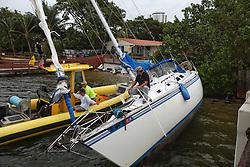 October 7, 2016 - Riviera Beach, Florida, U.S. - Hurricane Matthew pushed a sailboat against the Blue Heron Blvd. causeway near Phil Foster Park in Riviera Beach on Friday. (Credit Image: © Handout/The Palm Beach Post via ZUMA Wire)