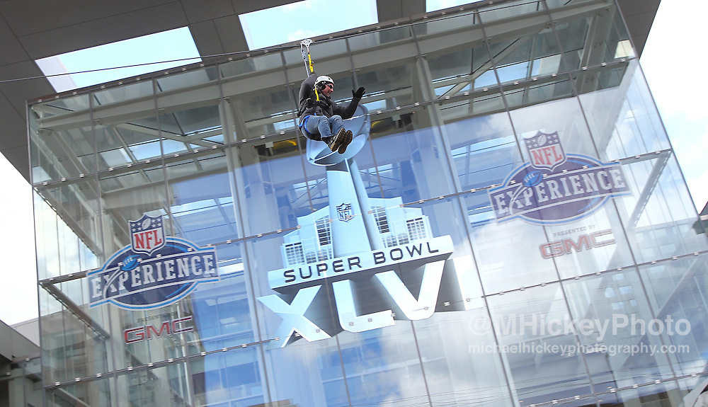 Jan. 29, 2012; Indianapolis, IN, USA; Fans ride the Super Bowl Village zip line outside of the NFL Experience at Indiana Convention Center. Mandatory credit: Michael Hickey-US PRESSWIRE