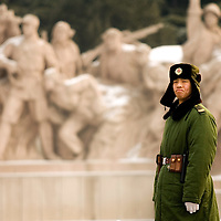 A paramilitary policeman stands guard in front of the Chairman Mao Zedong Mausoleum in Beijing's Tiananmen Square Monday Jan. 21, 2008. Photos: Bernardo De Niz