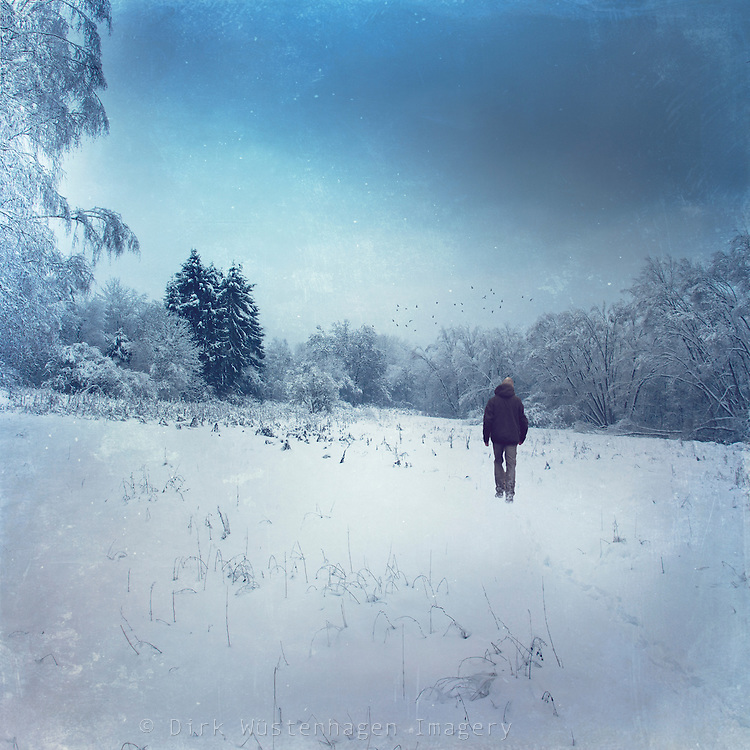 Man walking through a field of snow<br />