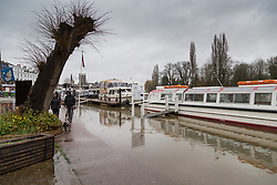 The rising waters have partially submerged a riverside road in Henley On Thames in Oxfordshire as heavy rains in the River Thames catchment area and saturated ground causes the river to rise to within inches of bursting its banks.. April 02 2018.
