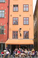 Outdoor cafe and colourful buildings<br /> in the old town square<br /> Stockholm, Sweden<br /> c. Ellen Rooney<br /> c. Ellen Rooney