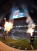 The gigantic overhead television screen shows Dallas Cowboys tight end Jason Witten (82) on the screen as part of the pregame festivities on the field as flames shoot up in the air before the Dallas Cowboys NFL week 8 regular season football game against the Washington Redskins on Monday, Oct. 27, 2014 Arlington, Texas. The Redskins won the game 20-17 in overtime. ©Paul Anthony Spinelli