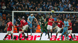 MANCHESTER, ENGLAND - Sunday, January 8, 2012: Manchester City's goalkeeper Costel Pantilimon wins a header in the Manchester United penalty area in injury time during the FA Cup 3rd Round match at the City of Manchester Stadium. (Pic by David Rawcliffe/Propaganda)