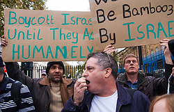Downing Street, London, November 15th 2014. Dozens of Palestinians and their supporters faced a small group of Israeli counter protesters as they demonstrated outside the gates of Downing Street against Israel. Police had to intervene as several from both sides took exception to what was being said, with the half-dozen-strong Israeli group eventually moving off. Pictured: A pro-Israrel counter-demonstrator is surrounded by pro-Palestine protesters as he uses his megaphone to call Hamas a terrorist organisation.