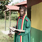 The Honorable Prophet Shadrack of the Bobo Shanti church, Shashamane, Ethiopia.<br /> <br /> Originally from Jamaica, he also lived in Ghana before repatriating in 2002. His father is also a Bobo priest at the same church.<br /> <br /> Bobo Shanti flag is red, yellow and green. The reason is that Bobos associate themselves more with Ghana. This differs from the Ethiopian flag (Which is associated with the Nyabinghi) which is green (Vegetation of Ethiopia), gold (Mineral wealth) and red (The blood of Ethiopians).<br /> <br /> The black star symbolises the Black Star Line (1919-1922). This was a shipping line created by Marcus Garvey to facilitate the transportation of goods and eventually African Americans throughout the African global economy.