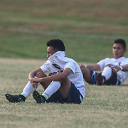 Delcastle midfielder Dustyn Salazar(6) sits on the field in tears after Newark FC Forward Diego Guzman (10) scores the winning goal in extra time during a regular season soccer match between Newark and Delcastle Thursday, Oct. 22, 2015 at Delcastle in Wilmington.
