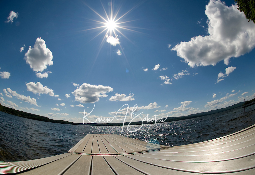 View of Lake Winnisquam on a glorious summer day..Watching the world go 'round..