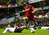 Photograph: Scott Heavey.<br />Tottenham Hotspur v Middlesbrough. FA Barclaycard Premiership. 26/10/2003.<br />Franck Queudrue skips over the challenge from Darren Anderton