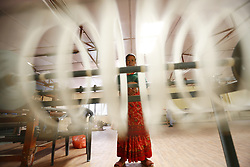 October 2, 2018 - Kathmandu, Nepal - A Nepalese woman who is victims of violence, abuse and poverty spins wool at a textile production center. The Production Center of Women's Foundation Nepal house more than 70 women aged above 45, who work to produce scarves, textiles and necklaces. (Credit Image: © Skanda Gautam/ZUMA Wire)