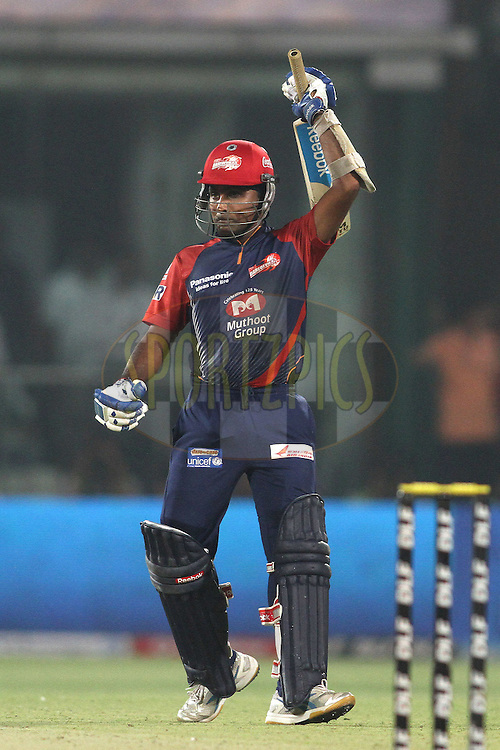 Mahela Jayawardene of the Delhi Daredevils raises his bat after reaching his fifty during match 64 of the the Indian Premier League (IPL) 2012  between The Delhi Daredevils and the Kings XI Punjab held at the Feroz Shah Kotla, Delhi on the 15th May 2012..Photo by Shaun Roy/IPL/SPORTZPICS