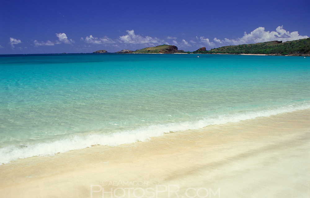 Blue sky, turquoise water and white sandy beach