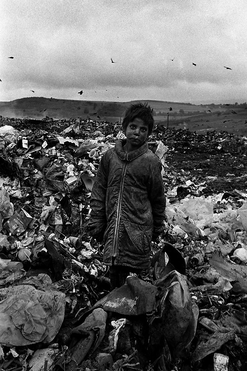 Gypsy children scavenge on the rubbish dump at the Roma community of Pata-Rat, Transylvania, Romania...©David Dare Parker / Network Photographers