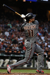 SAN FRANCISCO, CA - APRIL 09: A.J. Pollock #11 of the Arizona Diamondbacks hits an RBI sacrifice fly ball against the San Francisco Giants during the first inning at AT&T Park on April 9, 2018 in San Francisco, California.  (Photo by Jason O. Watson/Getty Images) *** Local Caption *** A.J. Pollock