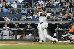 October 18, 2017 - Bronx, NY, USA - The New York Yankees' Starlin Castro hits a double in the second inning against the Houston Astros in Game 5 of the American League Championship Series at Yankee Stadium in New York on Wednesday, Oct. 18, 2017. (Credit Image: © Andrew Savulich/TNS via ZUMA Wire)