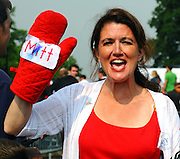 LAURA FONG | SUMMER KENT STATER Romney supporters raise a mitt for Mitt in Brunswick, Ohio Sunday.