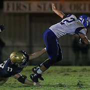 Middletown quarter back Vincent Delpercio (2) attempts to escape from Salesianum linebacker William<br /> Stradley (33) in the third quarter Friday, Oct. 09, 2015 at Bernard Stadium in Wilmington, DE.