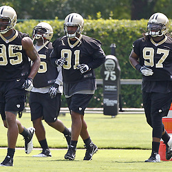 June 6, 2012; Metairie, LA, USA; New Orleans Saints linebacker and defensive end Martez Wilson (95) runs with teammates Tyrunn Walker (75), Will Smith (91) and Swanson Miller (97) during a minicamp session at the team's practice facility. Mandatory Credit: Derick E. Hingle-US PRESSWIRE