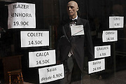 A shop window mannequin advertising prices of varieties of clothing, both academic and less formal styles for men and women, on 19th July, in Porto, Portugal. (Photo by Richard Baker / In Pictures via Getty Images)