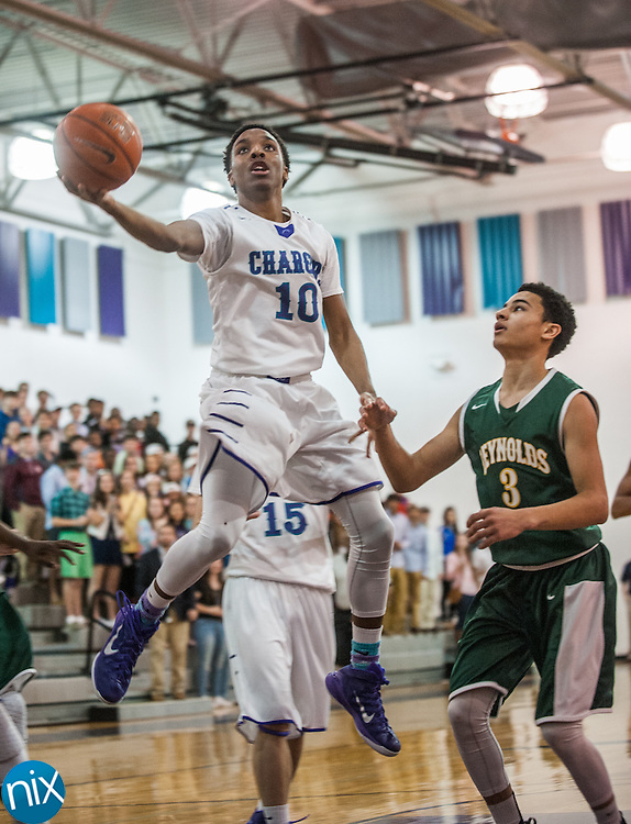 Cox Mill's Matt Morgan (10) goes up for a shot against A.C. Reynolds during a first round NCHSAA playoff game at Cox Mill High School Friday afternoon. Cox Mil won the game 74-62.