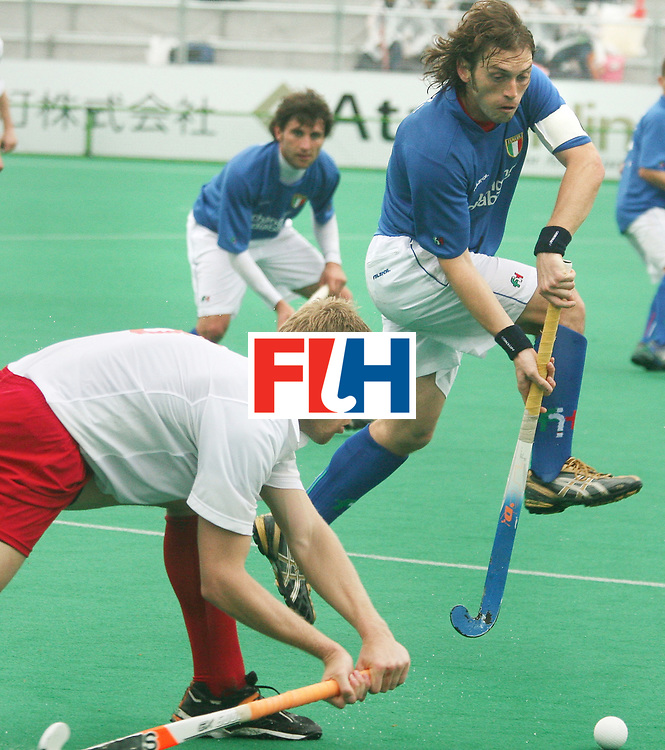 Kakamigahara (Japan): Lunetta Jacopo, the captain of the Italy team trying to get the ball from the Poland player  during the match between Poland V Italy in  the Olympic Hockey Qualifier at Gifu Perfectural Green Stadium at Kakamigahara on 10 April 2008. <br /> Poland beat Italy 6-0.<br />  Photo: GNN/ Vino John