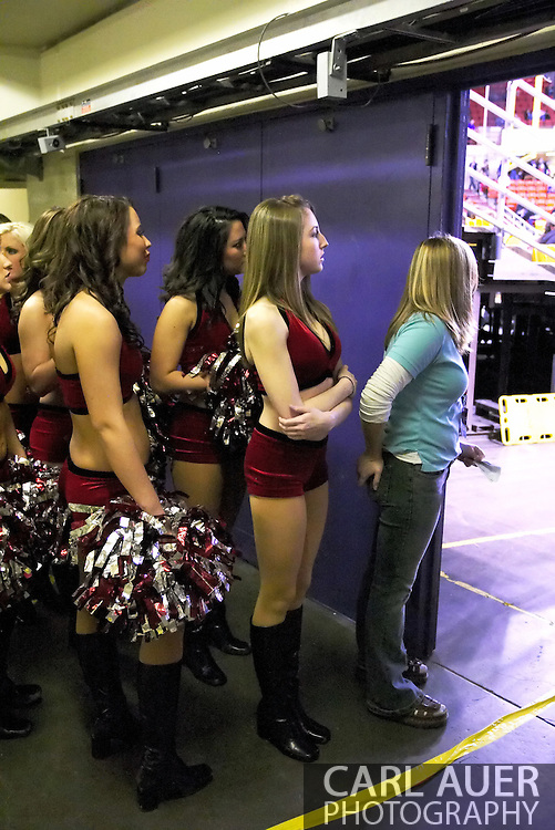 4/12/2007 - The Alaska Wild cheerleaders prepare to take the field for the first time.