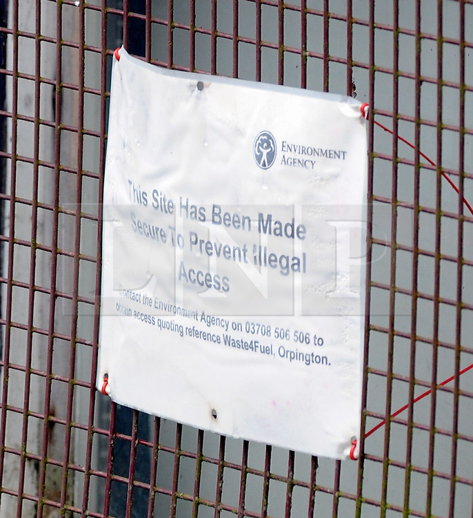 © Licensed to London News Pictures. 20/08/2015<br /> Environmrnt agency notice on the site office window.<br /> A mountain of waste still towers over local residents in St Pauls Cray,Orpington,Kent.  TODAY (20.08.2015)<br /> The residents of Cornwall Drive are still having to put up with a stinking smell,rats and fires coming from the  Waste4fuel site which is based at the end of the cul-de-sac.     The waste pile which is 40ft high can be clearly seen from Sidcup by-pass A20 and Crittalls Corner roundabout and is the first landmark visitors to the area are greeted with.<br /> <br /> <br /> (Byline:Grant Falvey/LNP)