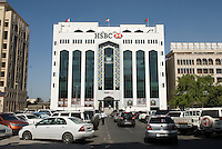 HSBC bank in old Dubai. Dubai, one of the seven emirates and the most populous of the United Arab Emirates sits on the southern coast of the Persian gulf.