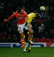 Photo: Richard Lane/Richard Lane Photography. Watford v Blackpool. Coca Cola Championship. 01/11/2008. Ben Burgess (L) and Lloyd Doyley(R) in the air