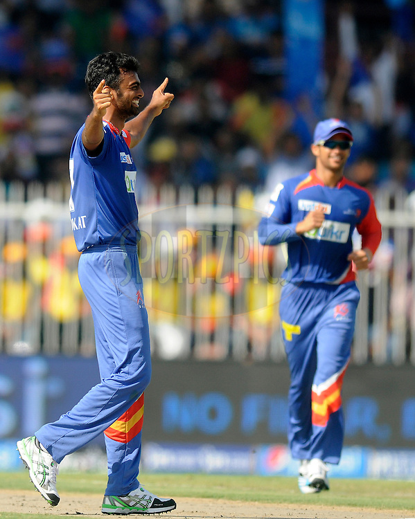 Jaydev Unadkat of the Delhi Daredevils celebrates the wicket of Michael Hussey of the Mumbai Indians during match 16 of the Pepsi Indian Premier League 2014 between the Delhi Daredevils and the Mumbai Indians held at the Sharjah Cricket Stadium, Sharjah, United Arab Emirates on the 27th April 2014<br /> <br /> Photo by Pal Pillai / IPL / SPORTZPICS